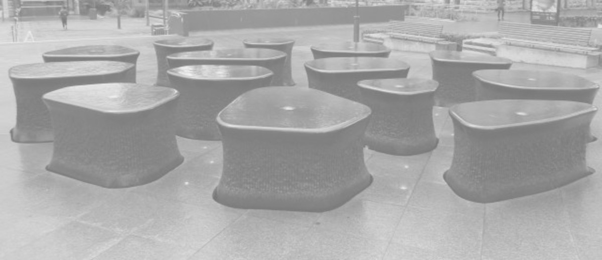 Image: sculpture of black stone with water