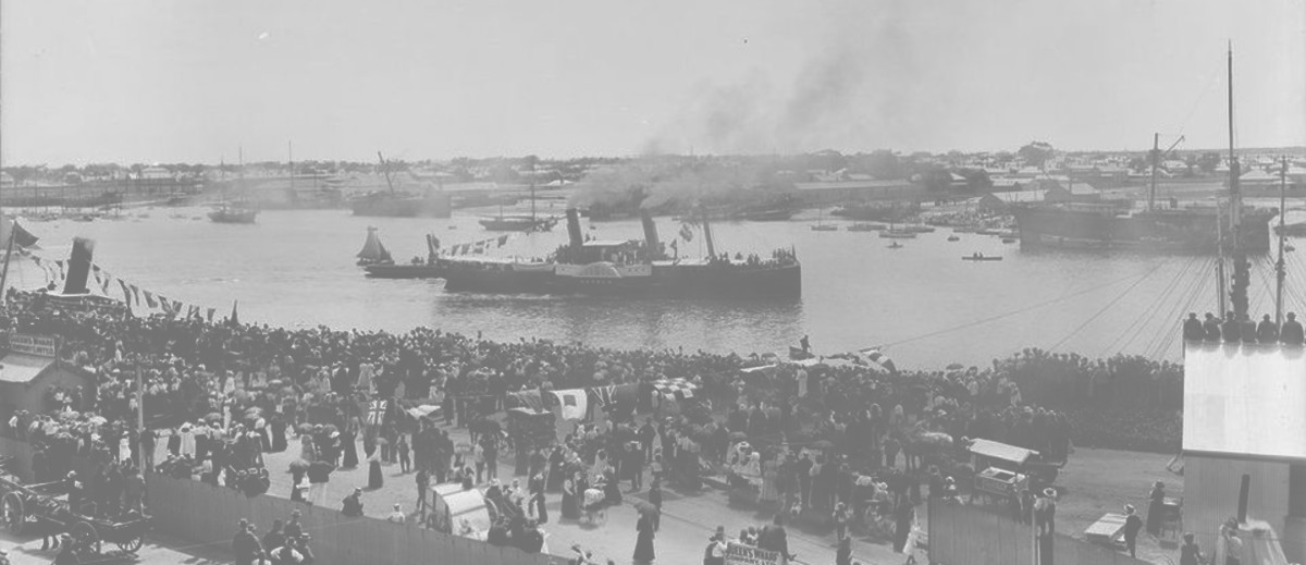 Image: Crowds of people at wharf where steam ship is docked