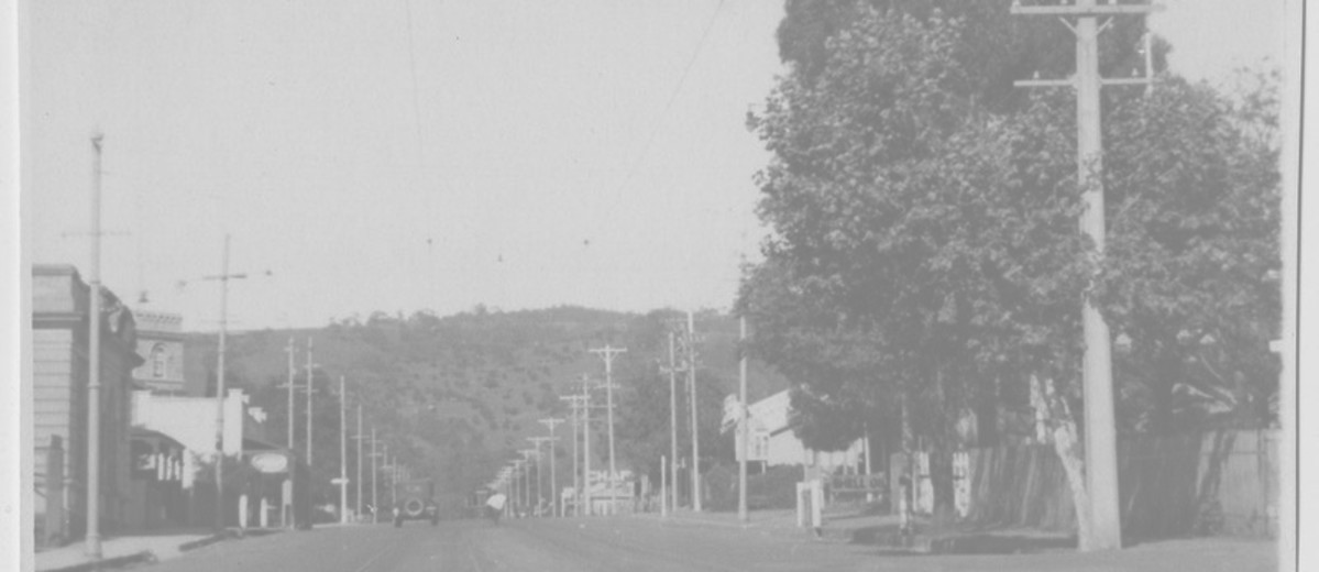 Image: view of street with poles lining each side