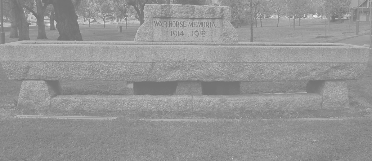 Image: large concrete trough engraved with memorial dates