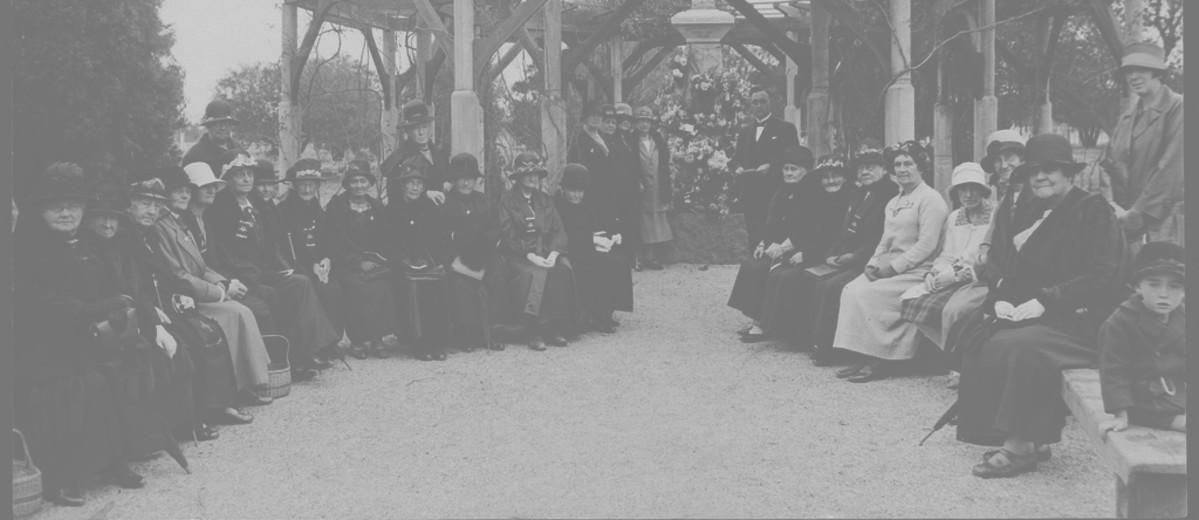 Image: group of people gathered under gazebo