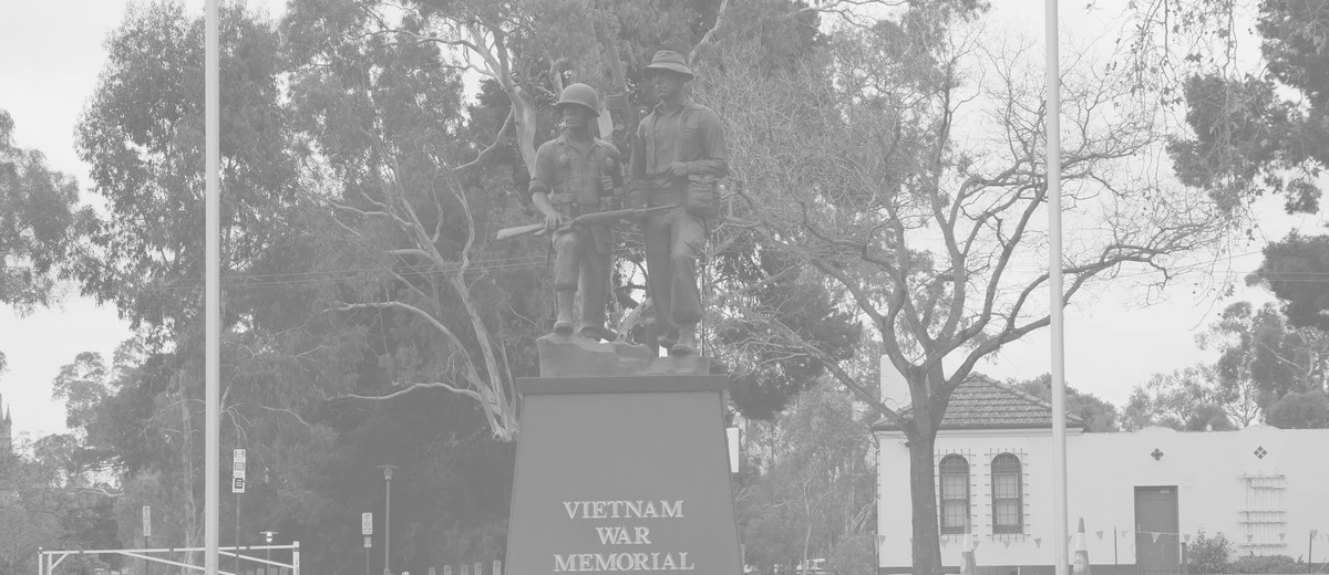 Image: Black memorial monument for the Vietnam War, front of memorial.