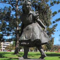 "Image: Bronze statue of girl on sandstone plinth inscribed ""ALICE for the children from Josephine and Norman Lewis 1962"""