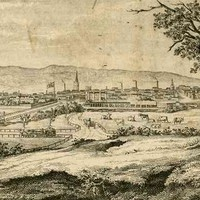 Image: a drawing of a small city as seen from a low hill