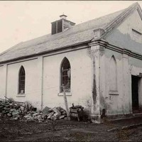 Image: black and white shot of simple, worn chapel