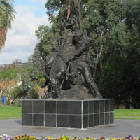 Image: sculpture of man on donkey carrying another man