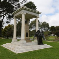 Image: Bronze statue and marble pillars