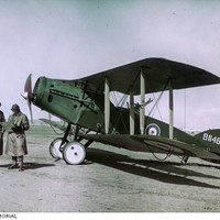 Image: Colour photo of two men and an aircraft