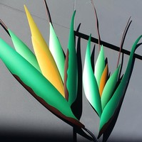 Image: 3D sculpture of Kangaroo grass against black gridded wall