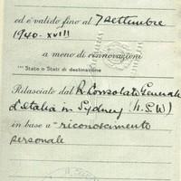 Image: open passport showing handwritten details