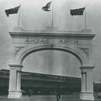 Image: Stone archway with three flags flying on top