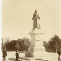 Image: people standing next to statue of woman