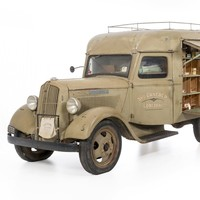 Image: khaki coloured van packed with goods