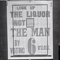 Image: black and white picture of poster stuck on glass