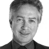 Image: black and white headshot of man