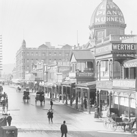 Image: Busy street scene with advertising on arcade dome