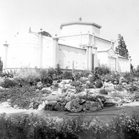 Image: Glasshouse surrounded by a rockery garden