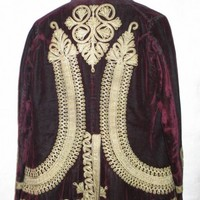 Image: Burgundy velvet male jacket.