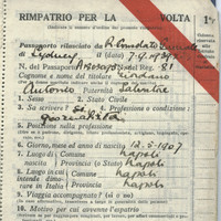 Image: open passport showing handwritten details