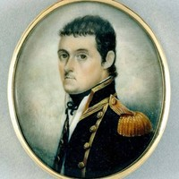 Image: a round miniature watercolour of the head and shoulders of a man with short dark brown hair posed in 3/4 profile wearing a high collared black military style coat with gold epaulettes, piping and buttons over a white shirt