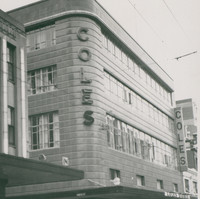 Image: a four storey building with a rounded corner, clad in shiny tiles