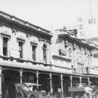 Image: Busy street scene with prominent building fronts