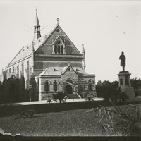 Image: view of a conservatorium building with a statue of a man in front