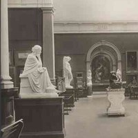 Image: The interior of an art gallery featuring a number of marble statues