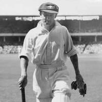Image: man walking with cricket bat
