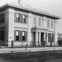 Image: photo of headquarters of the Woman's Christian Temperance Union. Letters W.C.T.U are written above the entrance