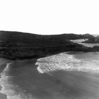 Image:View of high cliffs with the sea and beach below