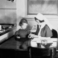 Image: woman in nurses uniform with young girl
