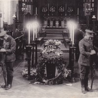 Image: Two soldiers standing guard next to a casket