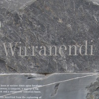Image: A sculpture comprised of four large stones stacked atop one another. The word 'Wirranendi' is inscribed in the top stone, along with additional informative text