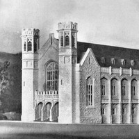 Image: An architect's model of a hall building with towers, windows recessed into stone arches, and a pitched roof