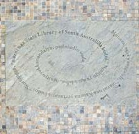 Image: words engraved in spiral shape in stone