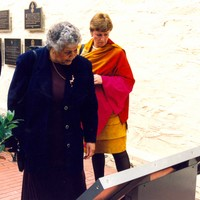 Image: two women looking at large outdoor plaque