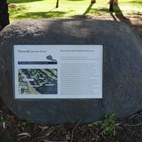 Image: Large graphic plaque set into granite boulder
