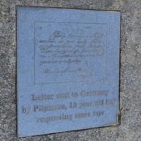 Image: bronze engraved plaque set in granite boulder