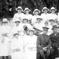 Image: group photo women with instruments, men in uniform