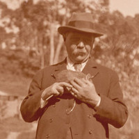 Image: Man in 1920's attire holding a possum