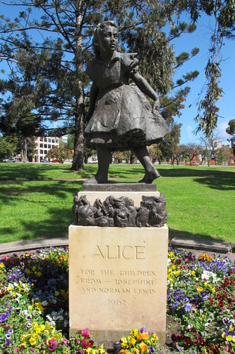 """Image: Bronze statue of girl on sandstone plinth inscribed """"ALICE for the children from Josephine and Norman Lewis 1962"""""""