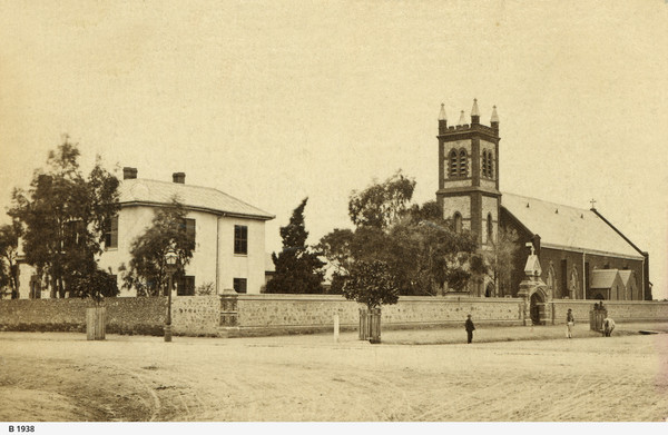 Image: street view of Grote street, showing Archbishop's House to the left, and Saint Patrick's Church to the right.