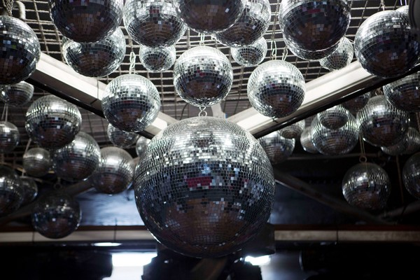 Image: a group of large mirror balls