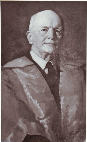 Image: A painted portrait of a middle-aged Caucasian man wearing a mid-twentieth century suit and academic regalia