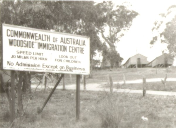 Image: sign outside migrant camp