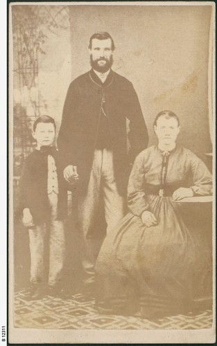 Image: seated woman with man and boy