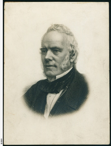 Image: head and shoulders portrait of a man with sideburns