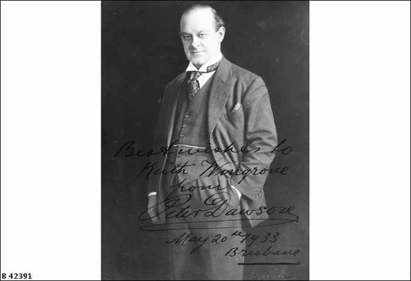 Image: A middle-aged, clean-shaven man in a suit poses for a full-length photographic portrait. An autograph on the photo reads 'Best Wishes to Keith Wingrove from Peter Dawson, May 20th 1933, Brisbane'
