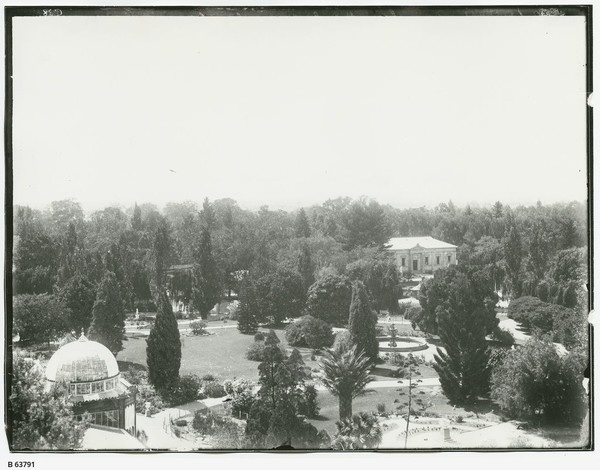 Image: View of a botanic garden, with glasshouse and museum